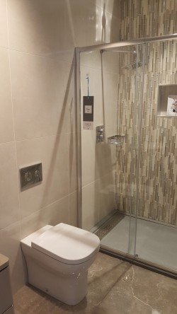 Bathrooms supplied and fitted by North West Tiles & Timber, Co. Leitrim, Ireland: including all sanitaryware, bathroom furniture, showers, baths and tiling