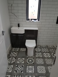 Patterned bathroom floor tiles,  toilet and  basin with subway wall tiles  in a Kilmore, County  Longford home installed by North West Tiles & Timber, Ireland