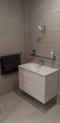 Wall hung white vanity unit - new bathroom installation in a  Cavan home  by North West Tiles & Timber, Ireland