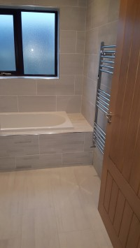 Tiled bath surround in a Carrick-on-Shannon home by North West Tiles & Timber, Ireland