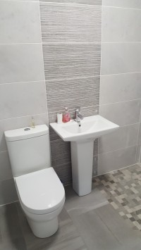 Toilet and basin in an en-suite wet-room  in Longford - design, supply and installation by  North West Tiles & Timber, Ireland